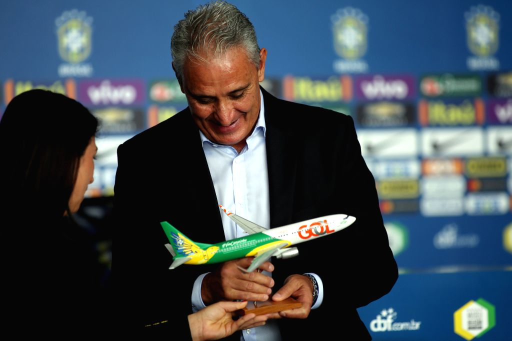 """SAO PAULO, March 4, 2017 - The head coach of the Brazilian national soccer team, Adenor Leonardo Bacchi """"Tite"""" (R), receives a replica of the new official airplane of the team during a ..."""