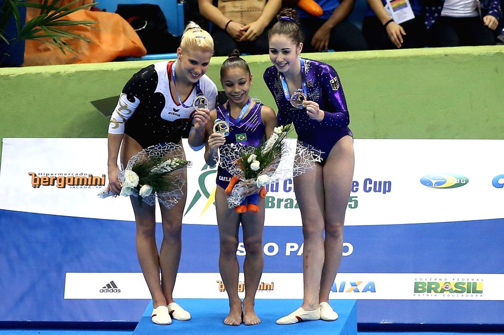 Silver medalist Elisabeth Seitz (L) of Germany, gold medalist Flavia Saraiva (C) of Brazil and bronze medalist Leah Griesser of Germany pose during the awarding ...