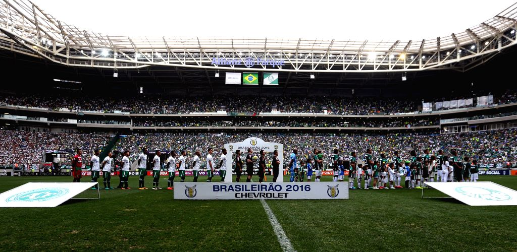 SAO PAULO, Nov. 29, 2016 - Photo taken on Nov. 28, 2016 shows players of Chapecoense team (L) and players of Palmeiras team (R) prior to a match of the Brazilian Championship, held at the Allianz ...