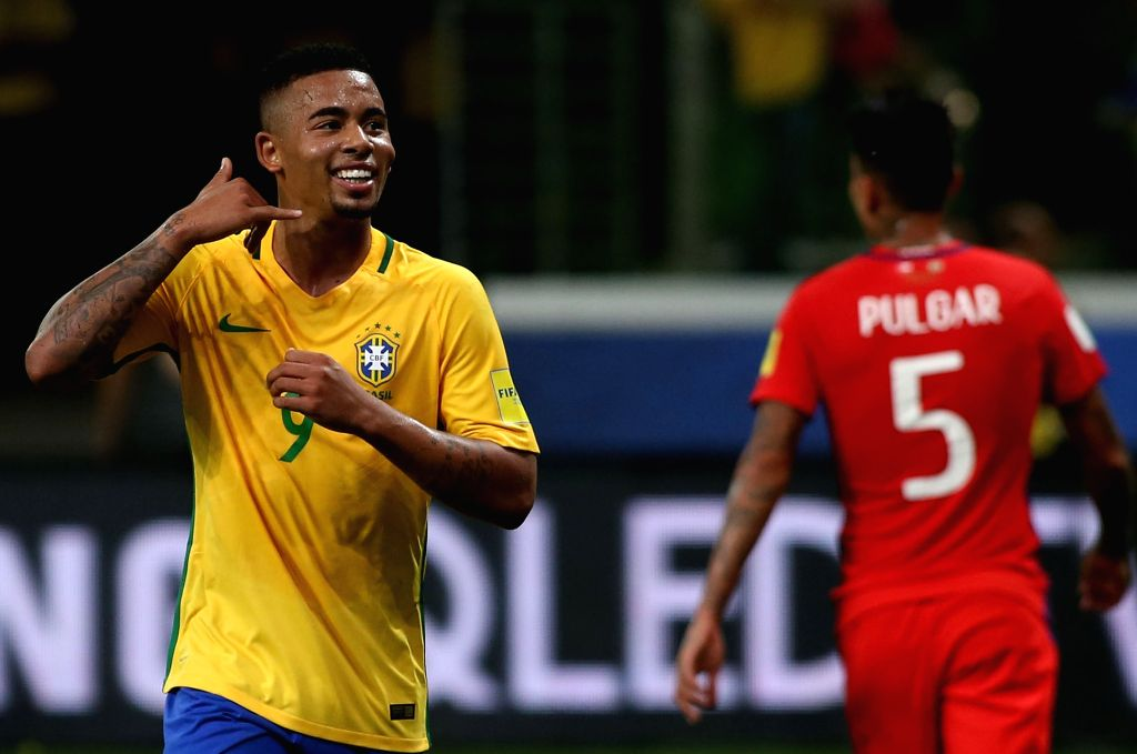 SAO PAULO, Oct. 11, 2017 - Brazil's Gabriel Jesus (L) celebrates after scoring during the Russia 2018 FIFA World Cup qualifier match against Chile, at Allianz Parque stadium, in Sao Paulo, Brazil, on ...