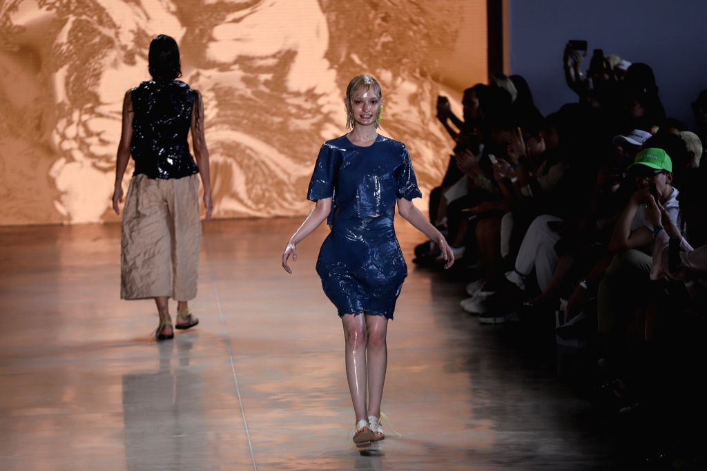 """SAO PAULO, Oct. 16, 2019 - Models present creations of """"AO"""" collection during the Sao Paulo Fashion Week (SPFW)  in Sao Paulo, Brazil, on Oct. 15, 2019. The six-day, 48th SPFW will last ..."""