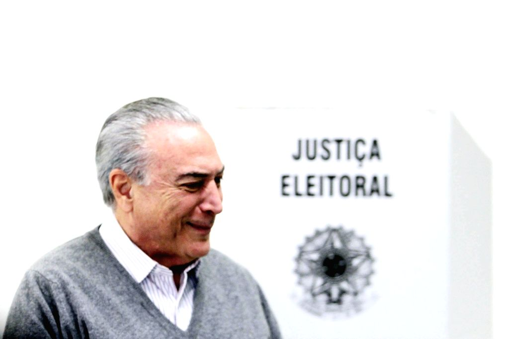 SAO PAULO, Oct. 2, 2016 - Brazilian President Michel Temer arrives to cast his ballot during the municipal elections in Sao Paulo, Brazil, on Oct. 2, 2016. Brazil voted on Sunday for the mayors and ...