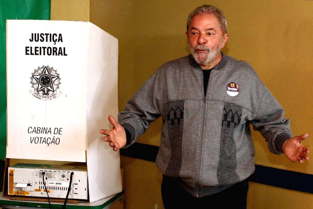 SAO PAULO, Oct. 2, 2016 - Former Brazilian President Luiz Inacio Lula da Silva arrives to cast his ballot during the municipal elections in Sao Paulo, Brazil, on Oct. 2, 2016. Brazil voted on Sunday ...