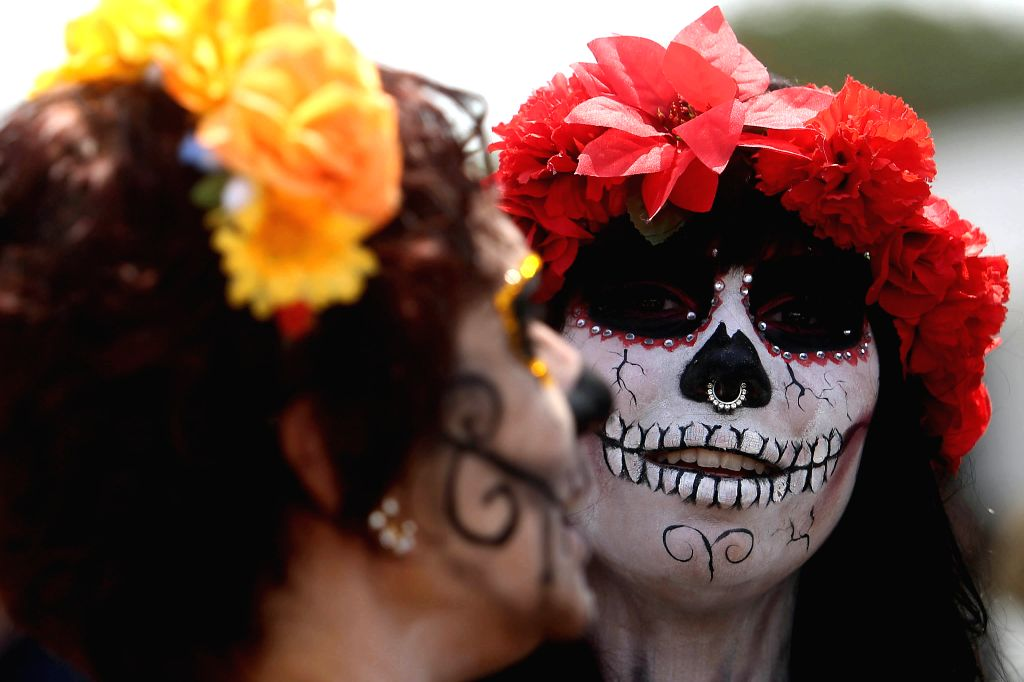 SAO PAULO, Oct. 31, 2016 - People in special costumes take part in the Feast of the Dead in Sao Paulo, Brazil, on Oct. 30, 2016. The Mexican community in Sao Paulo gathered during the weekend to mark ...