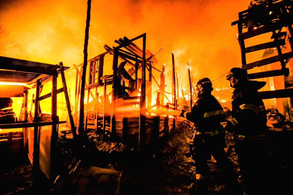 SAO PAULO, Sept. 14, 2016 - Firefighters try to extinguish the fire at the community of Osasco on the outskirts of Sao Paulo, Brazil, on Sept. 13, 2016. According to Sao Paulo's fire department, no ...