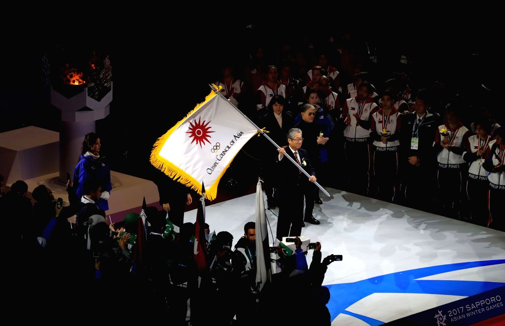 SAPPORO, Feb. 26, 2017 - Tsunekazu Takeda, president of Japan's Olympic Committee, waves the flag of Olympic Council of Asia during the closing ceremony of the 2017 Sapporo Asian Winter Games in ...