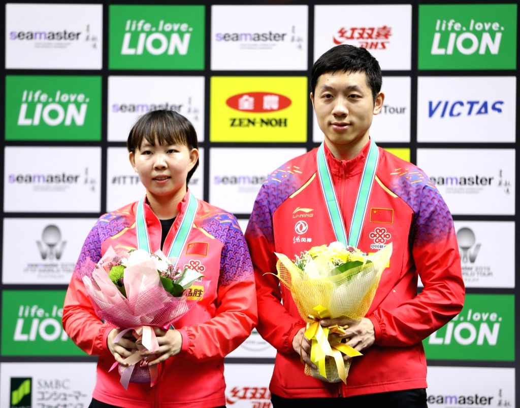 SAPPORO, June 15, 2019 - Xu Xin (R) and Zhu Yuling of China pose during the awarding ceremony after the mixed doubles final against Tomokazu Harimoto and Hina Hayata of Japan at ITTF World Tour ...