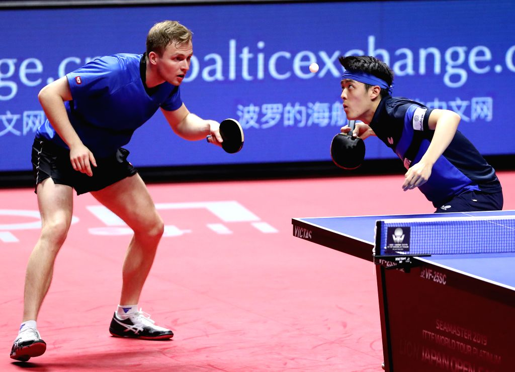 SAPPORO, June 16, 2019 - Benedikt Duda (L) and Qiu Dang of Germany compete during the men's doubles final against Fan Zhendong and Xu Xin of China at ITTF World Tour Platinum Japan Open in Sapporo, ...
