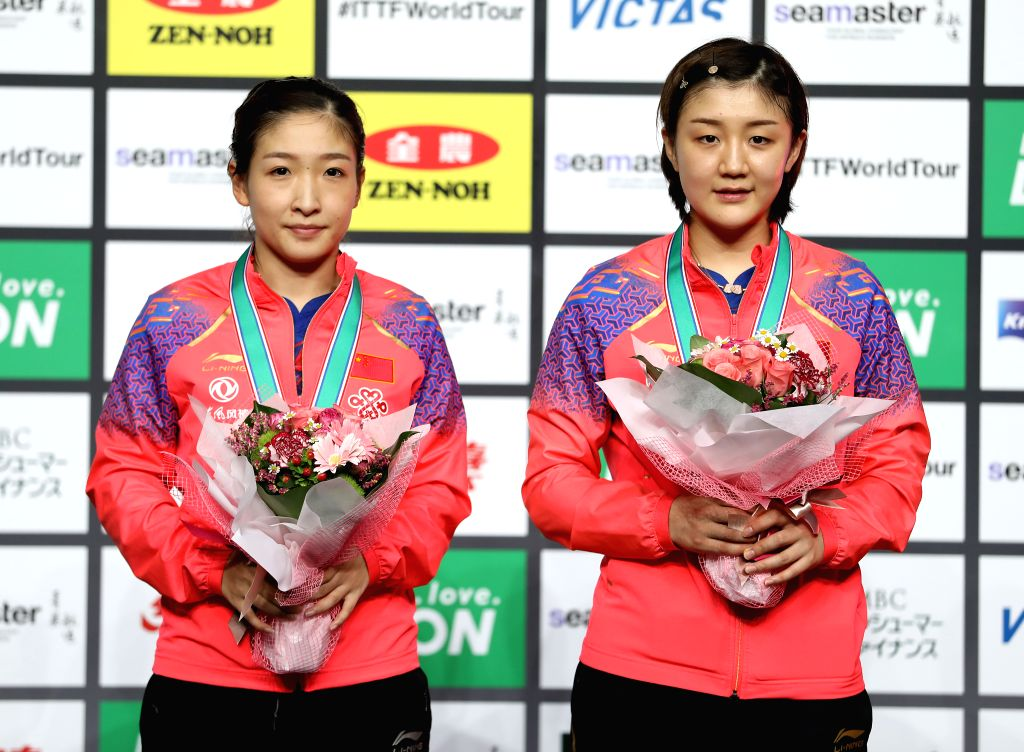SAPPORO, June 16, 2019 - Chen Meng (R) and Liu Shiwen of China pose during the awarding ceremony after the women's doubles final against Sun Yingsha and Wang Manyu of China at ITTF World Tour ...