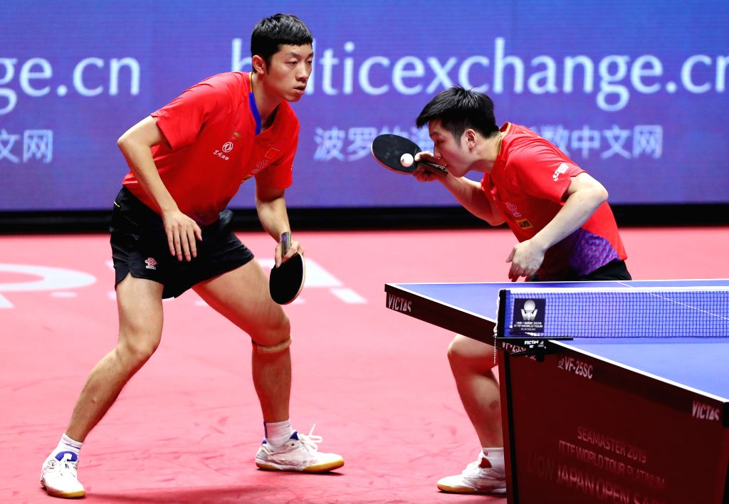 SAPPORO, June 16, 2019 - Fan Zhendong (R) and Xu Xin of China compete during the men's doubles final against Benedikt Duda and Qiu Dang of Germany at ITTF World Tour Platinum Japan Open in Sapporo, ...