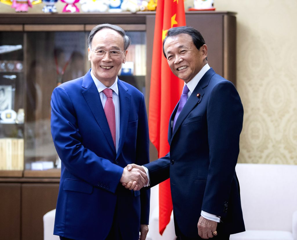 SAPPORO, Oct. 25, 2019 - Chinese Vice President Wang Qishan (L) meets with Japanese Deputy Prime Minister and Finance Minister Taro Aso in Tokyo, Japan, Oct. 22, 2019. Chinese Vice President Wang ... - Taro Aso