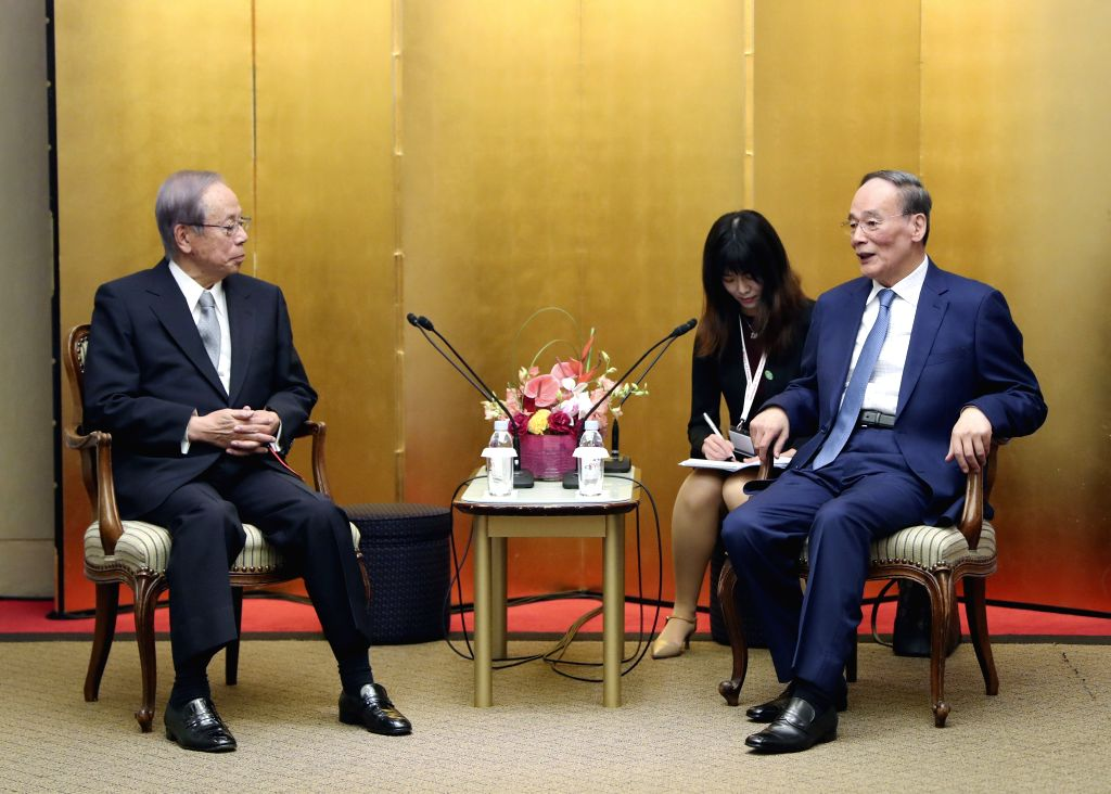 SAPPORO, Oct. 25, 2019 - Chinese Vice President Wang Qishan (R) meets with Japanese former Prime Minister Yasuo Fukuda in Tokyo, Japan, Oct. 22, 2019. Chinese Vice President Wang Qishan on Friday ... - Yasuo Fukuda
