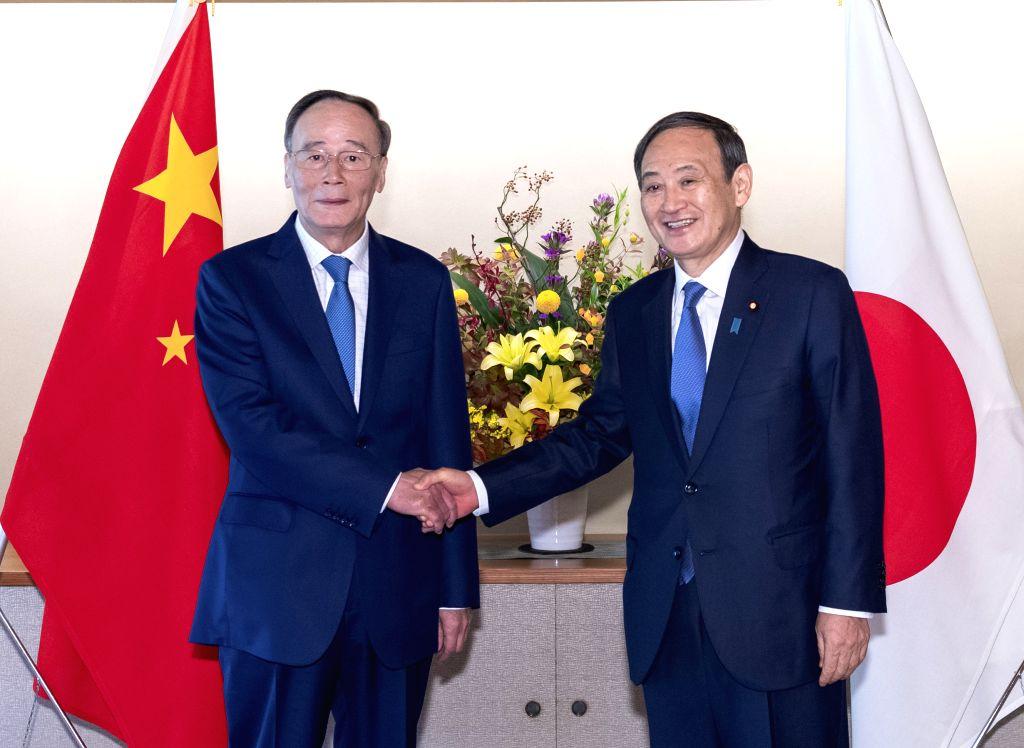 SAPPORO, Oct. 25, 2019 - Chinese Vice President Wang Qishan (L) meets with Japanese Chief Cabinet Secretary Yoshihide Suga in Tokyo, Japan, Oct. 23, 2019. Chinese Vice President Wang Qishan on Friday ...