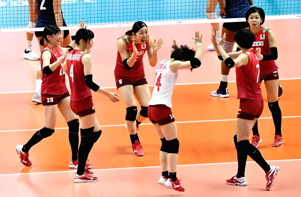 SAPPORO, Sept. 22, 2019 - Players of Japan celebrate during the Round Robin match between Japan and the United States at the 2019 FIVB Women's World Cup in Sapporo, Japan, Sept. 22, 2019.