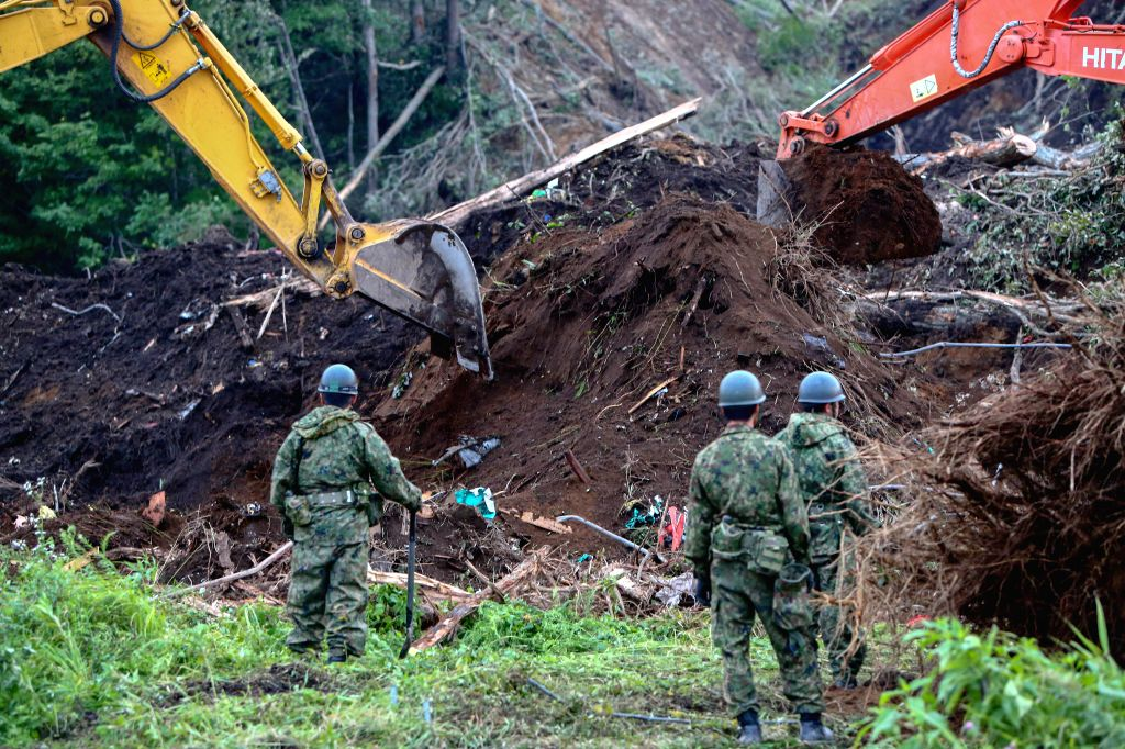 SAPPORO, Sept. 8, 2018 - Rescue members operate excavators at a site of landslide due to earthquake in the town of Atsuma, Hokkaido prefecture, Japan, on Sept. 7, 2018. A total of 21 people have been ...