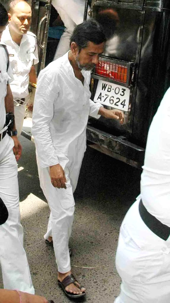 Saradha Group owner Sudipto Sen being produced at a court in connection of multi-crore chit fund scam in Kolkata on April 17, 2014.