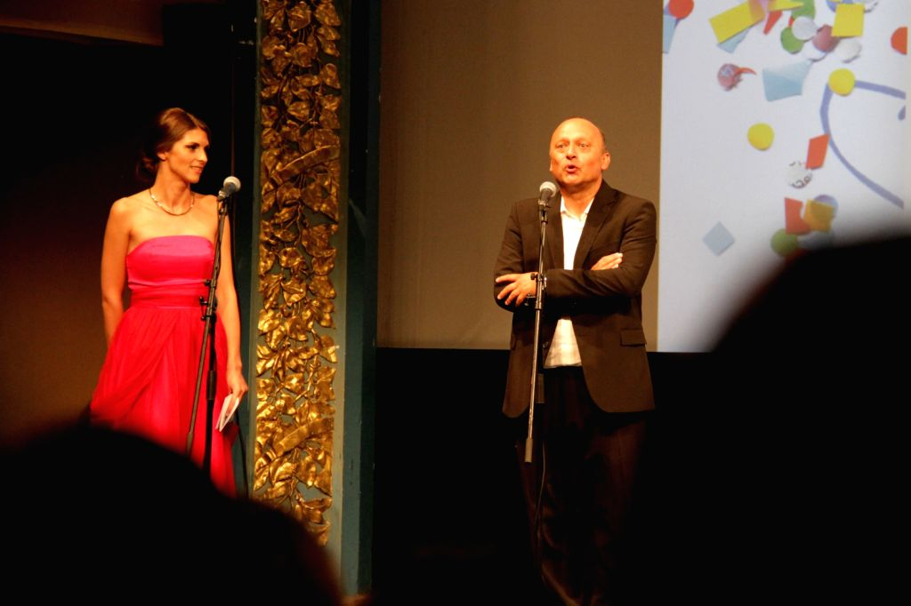 Director of Sarajevo Film Festival (SFF) Mirsad Purivatra (R) welcomes the audience, at the beginning of the opening ceremony, in Sarajevo, Bosnia and ...