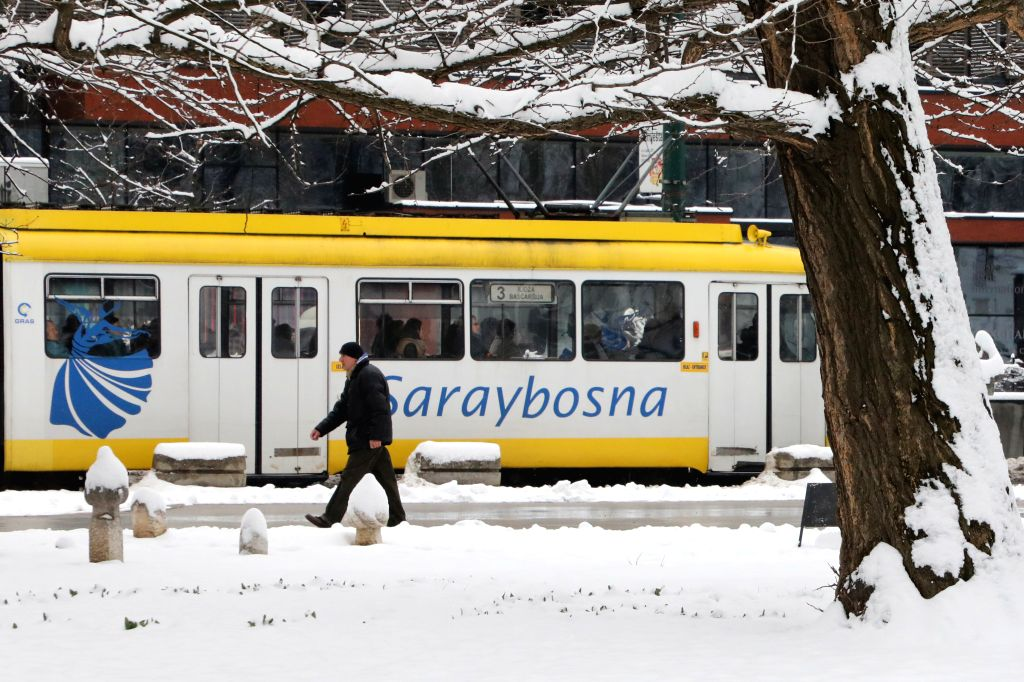 SARAJEVO, March 21, 2018 - A man walks in Sarajevo, Bosnia and Herzegovina, on March 21, 2018. A snowstorm hit Sarajevo on Wednesday.