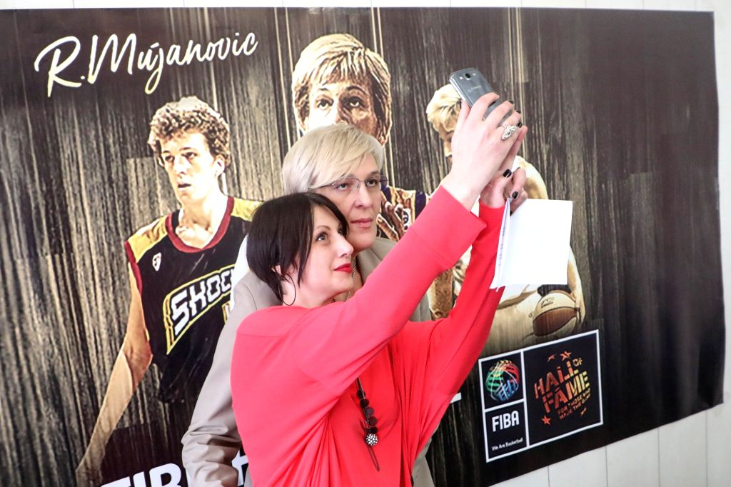SARAJEVO, Oct. 10, 2017 - Legendary Bosnian basketball player Razija Mujanovic (Rear) and her fan pose for a photo in Sarajevo, Bosnia and Herzegovina, on Oct. 10, 2017. Mujanovic entered the ...
