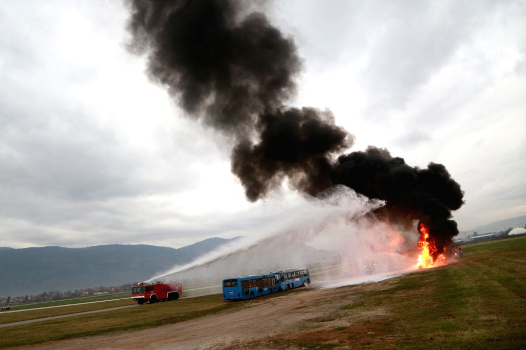 SARAJEVO, Oct. 26, 2016 - A fire truck extinguishes a fire during an emergency rescue drill at Sarajevo International Airport, Bosnia and Herzegovina, on Oct. 26, 2016.