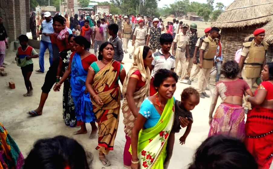 Saran: Locals gather at the site where three men were allegedly thrashed to death and one critically injured by villagers over suspicion of cattle theft in Bihar's Saran district on July 19, 2019. The deceased were identified as Naushad Quraishi, Raj