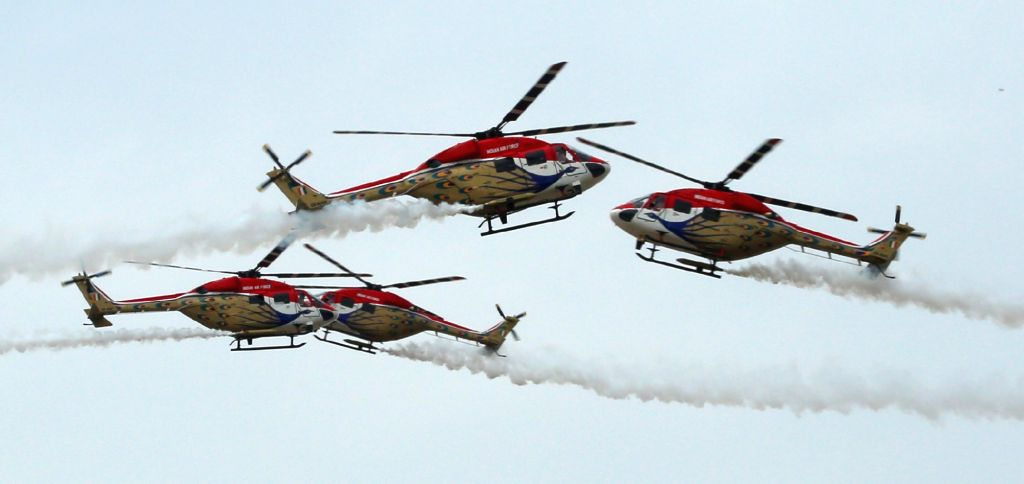 Sarang Air Force Helicopter team perform during Combined Graduation Parade at Air Force Academy at Dundigal in Hyderabad on June 17, 2017.