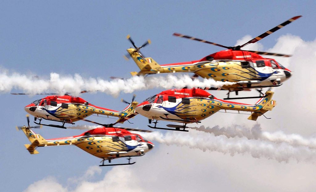 Sarang Helicopters display during 9th Edition of Aero India Show 2013 at Yelahanka Air force Station in Bengaluru on Wednesday 6th of February 2013.
