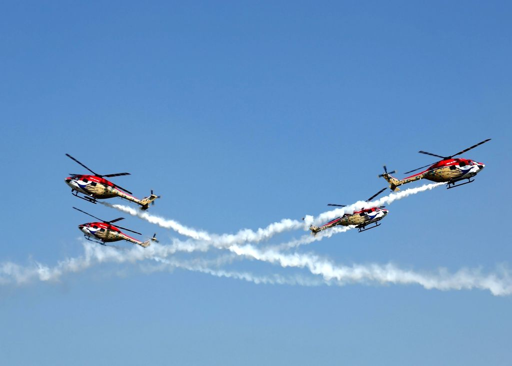 Sarang helicopters display maneuvers during the 87th anniversary celebrations of the Indian Air Force (IAF) at Hindon Air Force Station in Ghaziabad, on Oct 8, 2019.