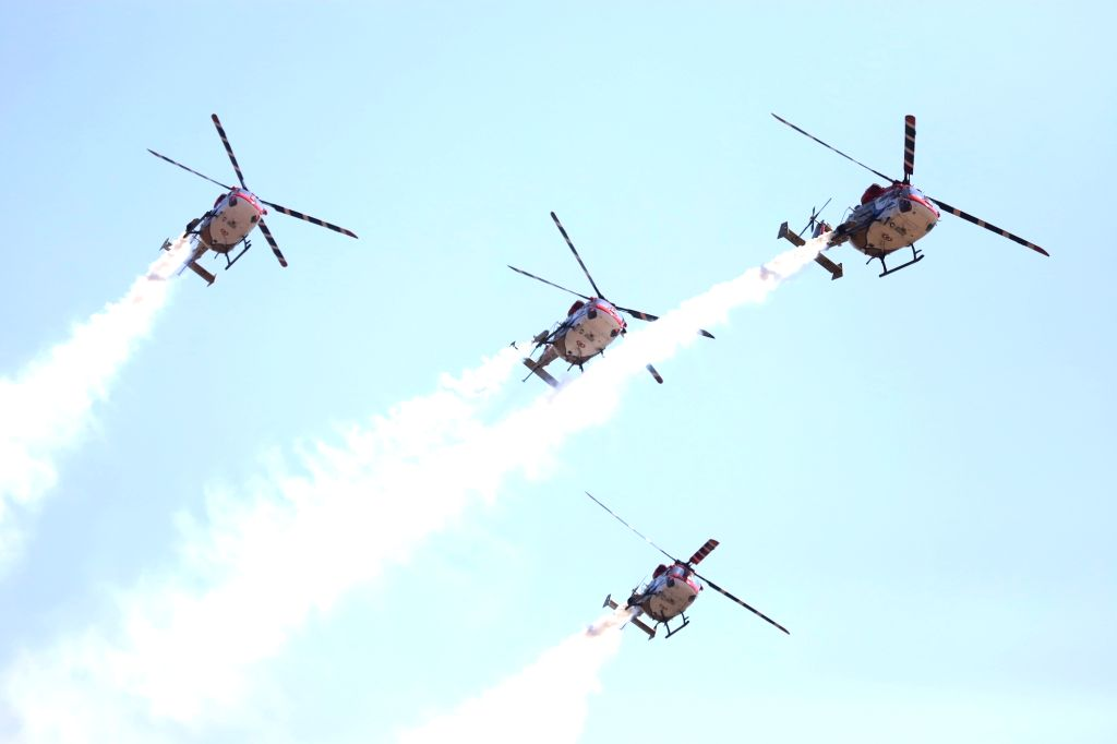 "Sarang helicopters perform during the inauguration of the ""Aero India 2019"" - air show at Yelahanka Air Force Station, in Bengaluru, on Feb 20, 2019."