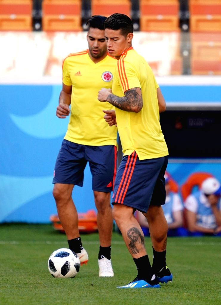 SARANSK, June 18, 2018 - Colombia's James Rodriguez (R) and Radamel Falcao are seen during a training session prior to a group H match against Japan at the 2018 FIFA World Cup in Saransk, Russia, on ...