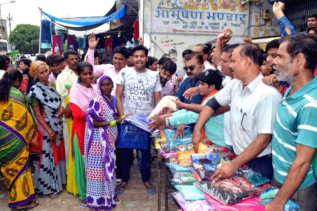 Saree traders distribute free sarees to protest against GST that came into force from 1st July, 2017;  in Agra, on July 5, 2017.