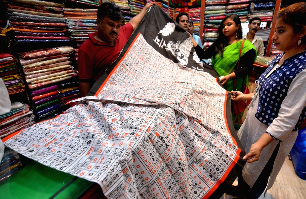 Sarees carrying the images of 2019 Bengali calendars being sold at a shop ahead of Bengali New Year, in Kolkata on April 9, 2019.