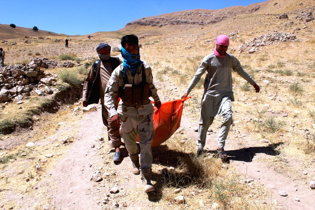 SARI PUL, Aug. 16, 2017 - People carry the body of a victim of militants attack in Mirza Olang district of Sari Pul province, Afghanistan, Aug. 15, 2017. Local Afghans and security forces discovered ...