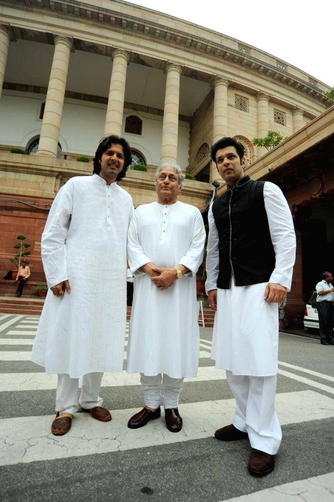 Sarod maestro Ustad Amjad Ali Khan with his sons Amaan Ali Khan and Ayaan Ali Khan at the Parliament on Aug 5, 2014. - Amaan Ali Khan and Ayaan Ali Khan
