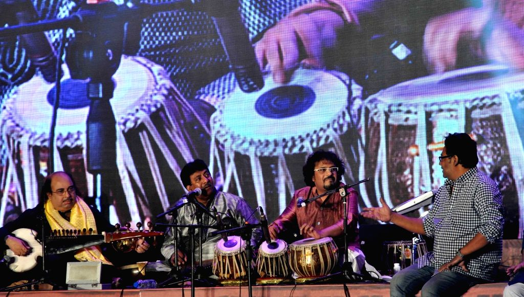 Sarod player Tejendra Majumdar, singers Ustad Rashid Khan and Indranil Sen and percussionist Bickram Ghosh   perform during the inauguration of the 21st Kolkata International Film Festival ... - Ustad Rashid Khan and Bickram Ghosh