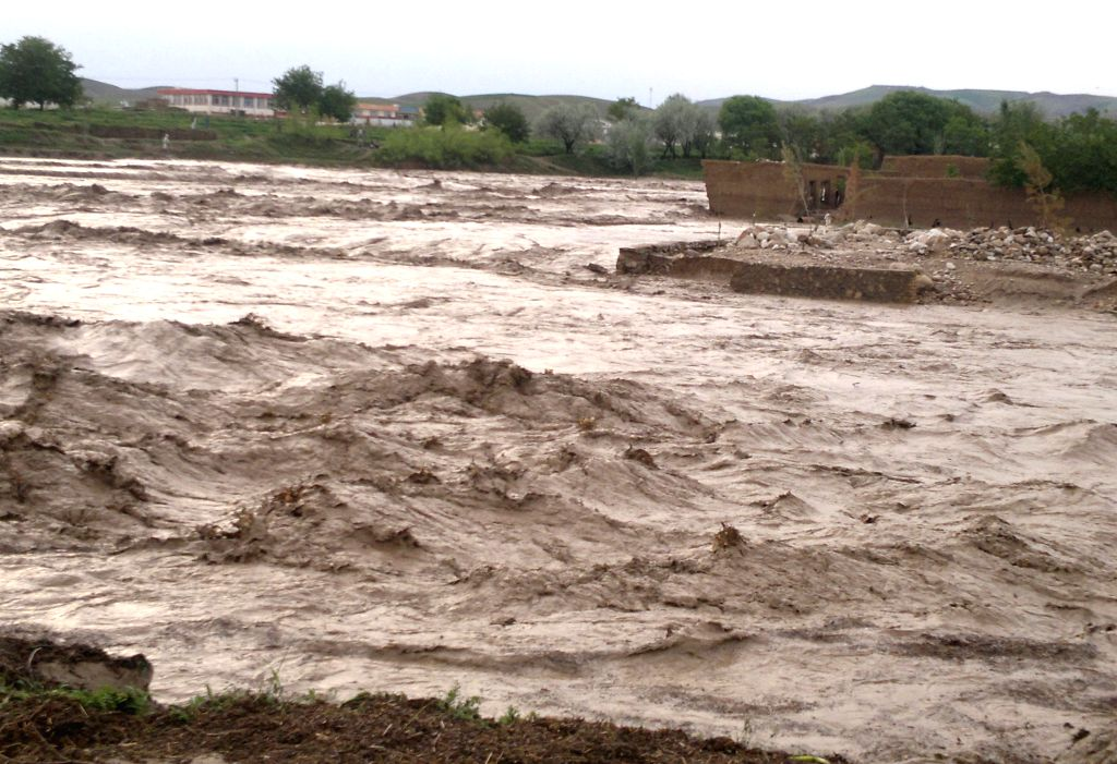 Photo taken on April 25, 2014 shows the flood-hit area in Sarpul province, northern of Afghanistan. Heavy rains and flooding have claimed the lives of nearly 40 ...