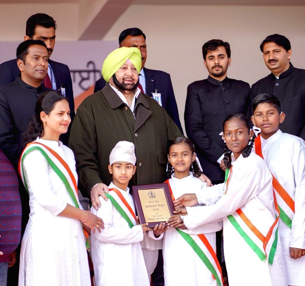 SAS Nagar: Punjab Chief Minister Captain Amarinder Singh honours group of specially-abled children that performed National Anthem during the 71st Republic Day celebrations in SAS Nagar district on ... - Captain Amarinder Singh