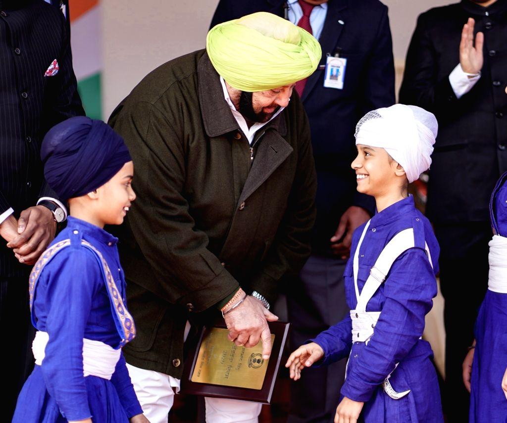 SAS Nagar: Punjab Chief Minister Captain Amarinder Singh honours young 'Gatka' performer during the 71st Republic Day celebrations in SAS Nagar district on Jan 26, 2020. - Captain Amarinder Singh