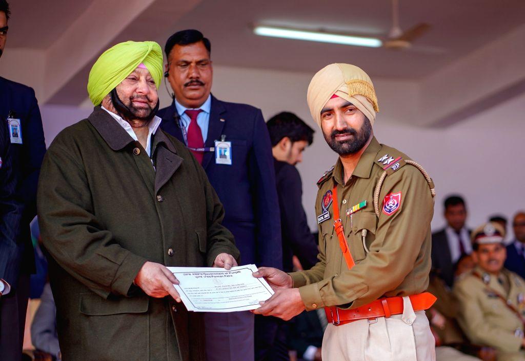 SAS Nagar: Punjab Chief Minister Captain Amarinder Singh honours Sub Inspector Satpal Singh during the 71st Republic Day celebrations in SAS Nagar district on Jan 26, 2020. - Captain Amarinder Singh and Inspector Satpal Singh