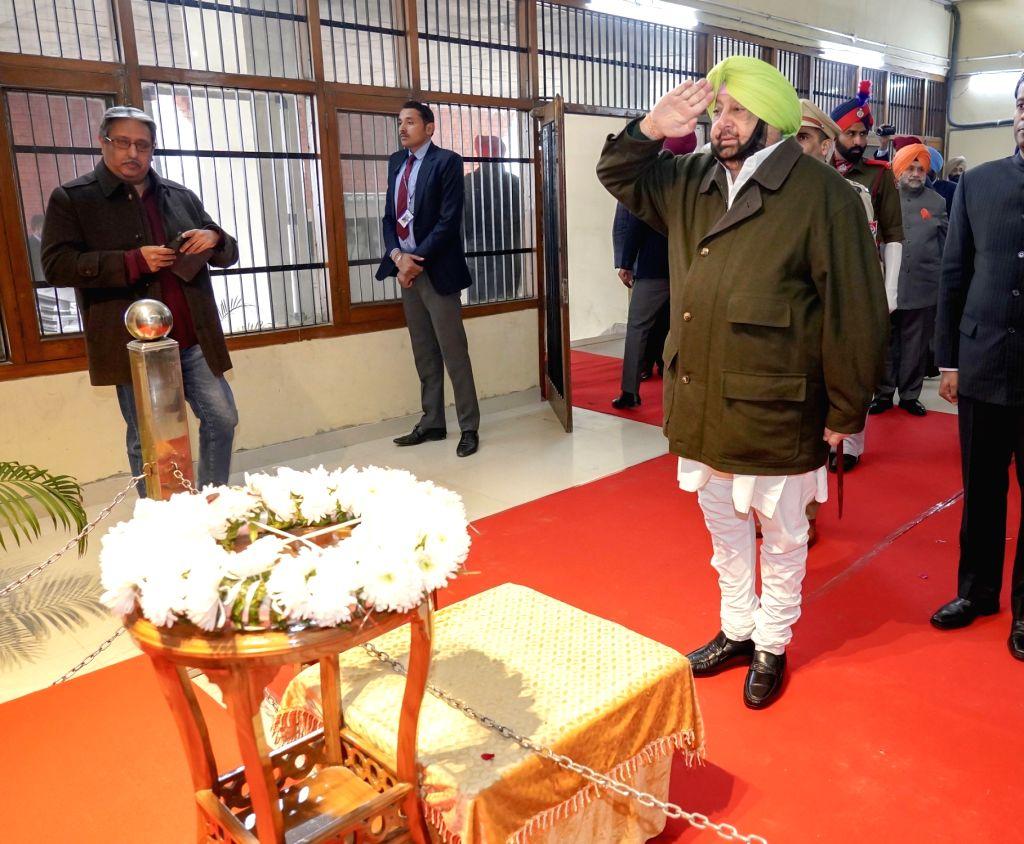 SAS Nagar: Punjab Chief Minister Captain Amarinder Singh -pays tributes to Shaurya Chakra awardee Major Harminder Pal Singh during the 71st Republic Day celebrations in SAS Nagar district on Jan 26, ... - Captain Amarinder Singh and Harminder Pal Singh