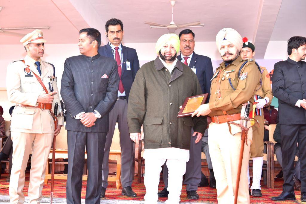 SAS Nagar: Punjab Chief Minister Captain Amarinder Singh honours SP Headquarter Ropar Jagjit Singh during the 71st Republic Day celebrations in SAS Nagar district on Jan 26, 2020. - Captain Amarinder Singh and Ropar Jagjit Singh