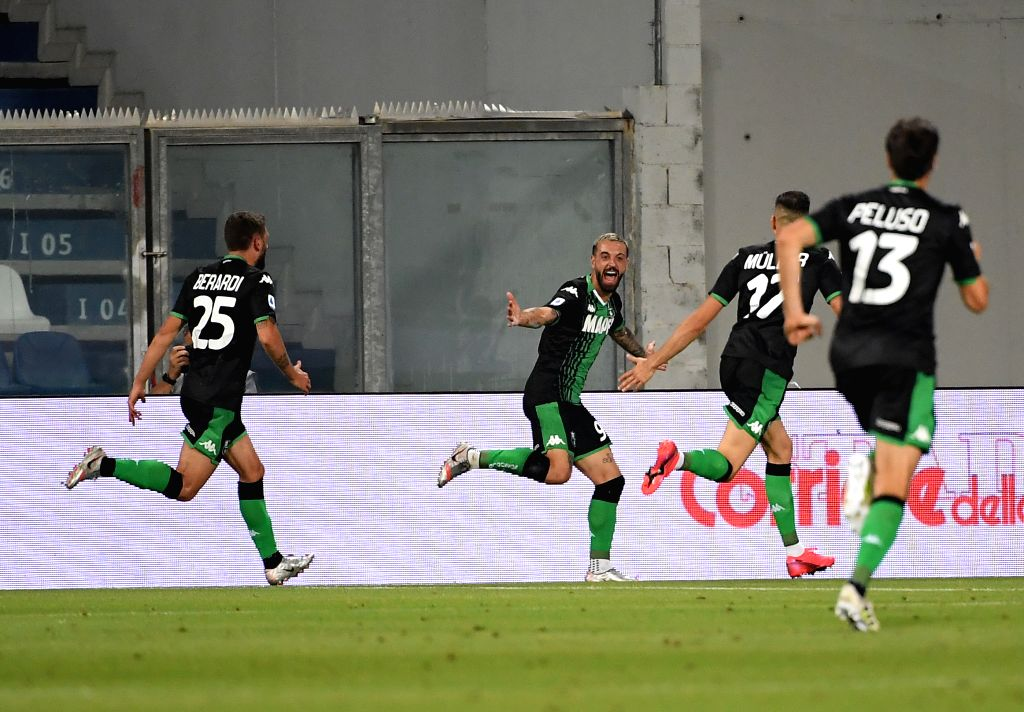 Sassuolo's Francesco Caputo (2nd L) celebrates after scoring during a Serie A football match between Sassuolo and Juventus in Reggio Emilia, Italy, July 15, ...