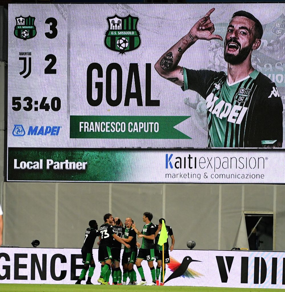 Sassuolo's players celebrate a goal during a Serie A football match between Sassuolo and Juventus in Reggio Emilia, Italy, July 15, 2020.