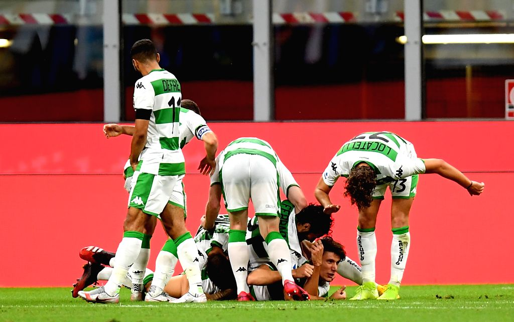 Sassuolo's players celebrate their goal during a Serie A football match between FC Inter and Sassuolo in Milan, Italy, June 24, 2020.