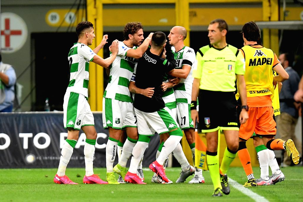 Sassuolo's players celebrates their goal during a Serie A football match between FC Inter and Sassuolo in Milan, Italy, June 24, 2020.