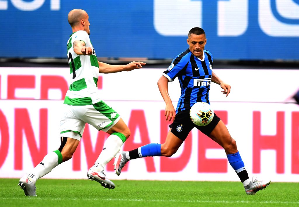 Sassuolo's Vlad Chiriches (L) vies with FC Inter's Alexis Sanchez during a Serie A football match between FC Inter and Sassuolo in Milan, Italy, June 24, 2020.