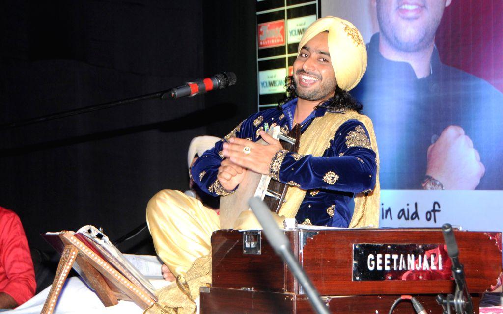 Satinder Sartaj Performing at Satinder Sartaj's `Mehefil-e-Sartaaj` live concert at Hotel Novotel in Juhu, Mumbai on Saturday, June 21, 2014.