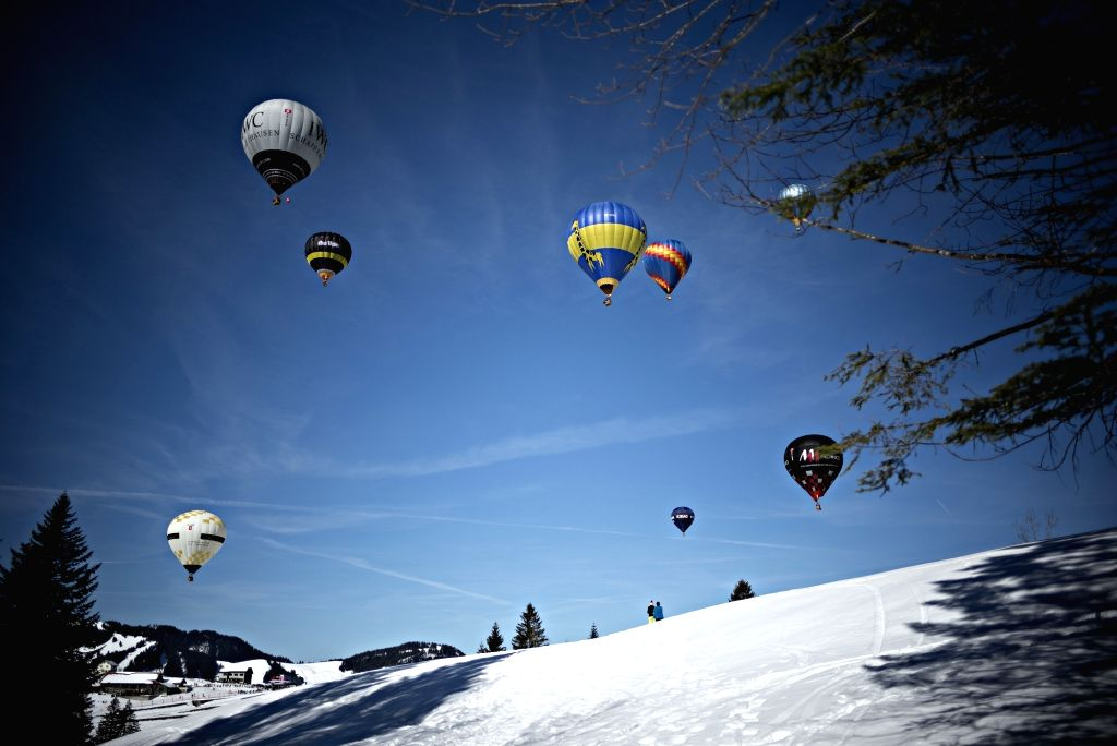 SATTEL, Feb. 18, 2019 - Participants fly their hot air balloons during the 22nd Stuckli Balloonfiesta in Sattel-Hochstuckli, Switzerland, Feb. 17, 2019. The festival held on Sunday attracted many hot ...