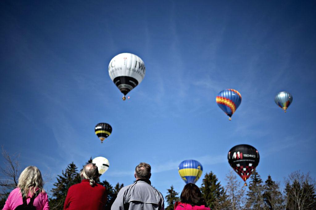 SATTEL, Feb. 18, 2019 - Visitors watch hot air balloons during the 22nd Stuckli Balloonfiesta in Sattel-Hochstuckli, Switzerland, Feb. 17, 2019. The festival held on Sunday attracted many hot air ...