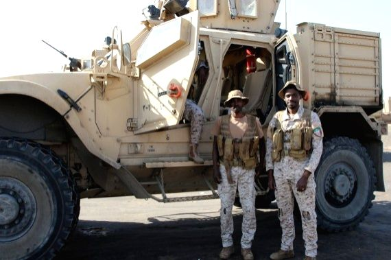 Saudi military officers are seen next to their armored vehicles on Dec. 13, 2020, in the southern province of Abyan, Yemen.